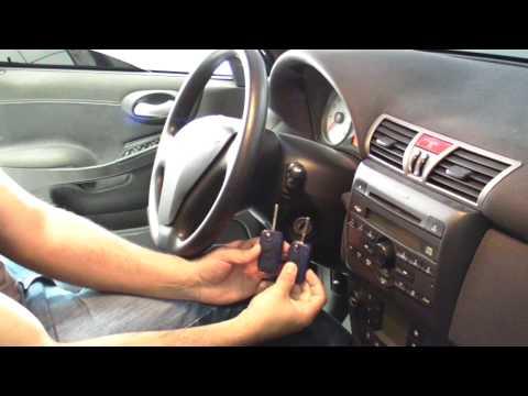 Chave de um Fiat Stilo Sporting abrindo dois Fiat Punto diferentes