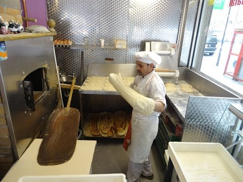 Master Baker Gino making Turkish Flat Bread Pide (Ekmeği) in a wood fired oven at Crystal, London