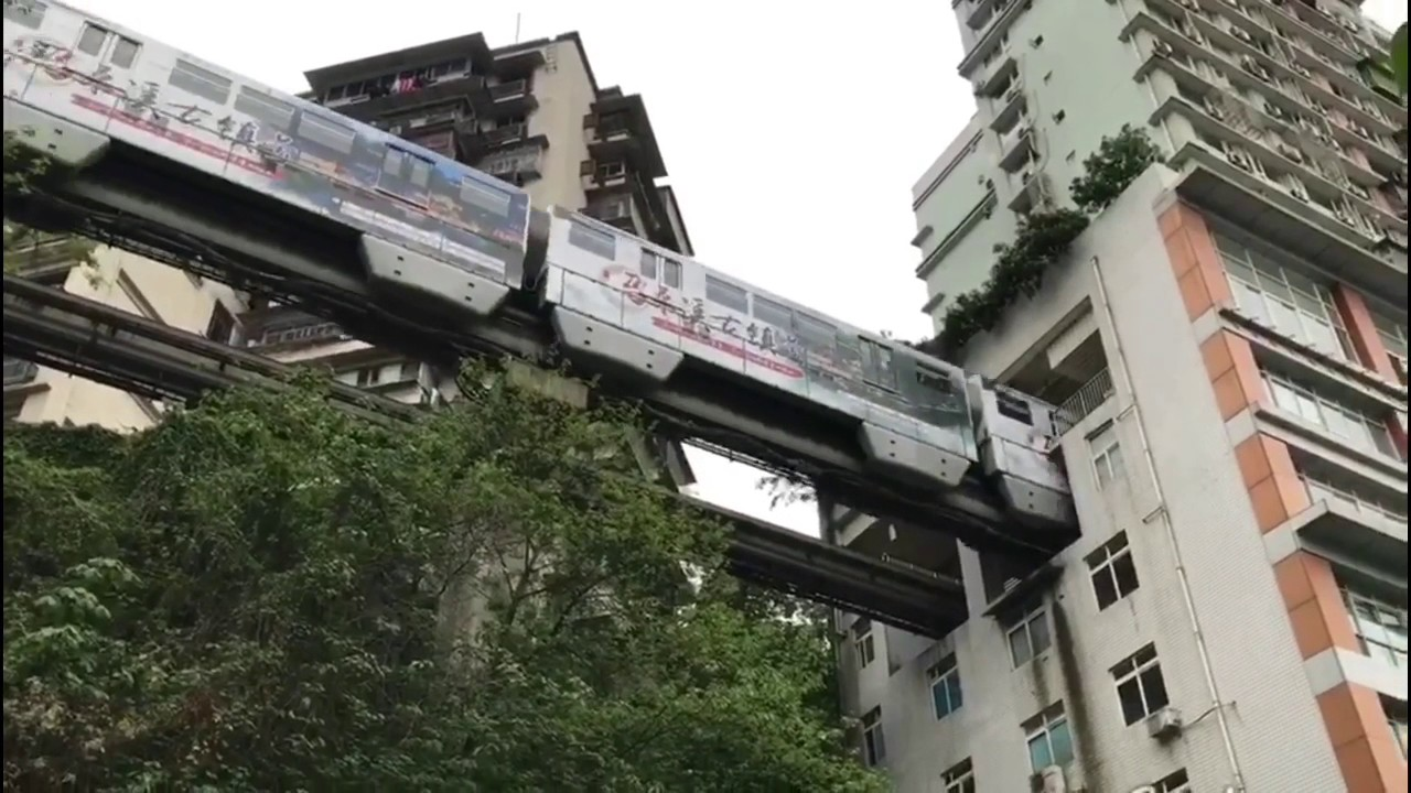 Monorail Train Passes Through Residential Building In