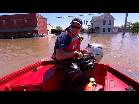 Arkansas levee breaks, flooding historic town