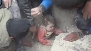 Amazing rescue: Buried baby is pulled from underneath rubble in Aleppo, Syria