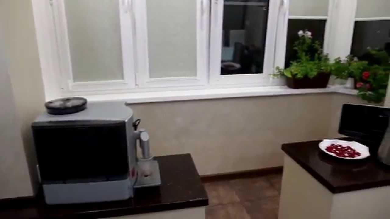 Максимус окна - пример совмещения лоджии с кухней.