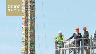 Children build world's tallest Lego tower in Milan
