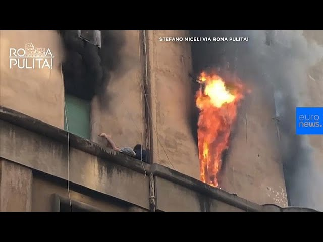 Man clings to outer shelf as flames rage from his Rome room