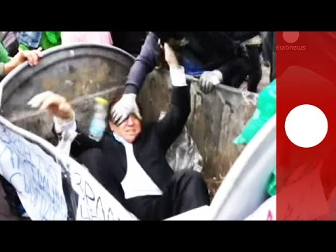 Angry mob throws Ukraine MP in rubbish bin