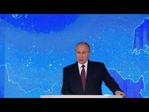 Putin looks to strengthen economy & military in address