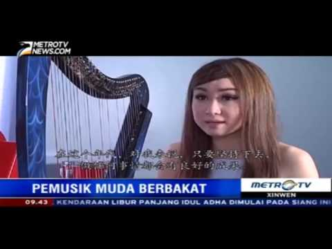Angela July - the 1st Vocalist Harpist in Indonesia (Metro Tv Xin Wen coverage)