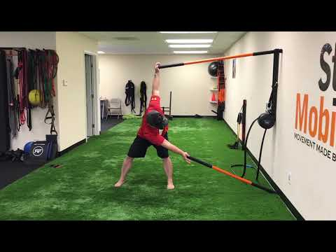 thoracic-spine-rotation-wall-drill---stick-mobility-exercise
