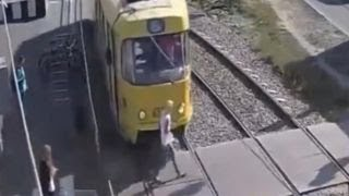 Warning, graphic video: Woman hit by train, loses leg