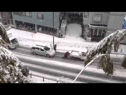 Heavy snow, skidding car in Tokyo