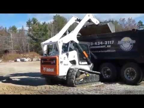 Bobcat T870 Loading Tri Axle Dump Truck