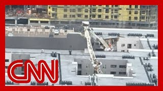 Crane collapses onto building in Dallas
