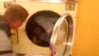 man in tumble dryer
