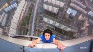 man almost falls off building while taking a selfie