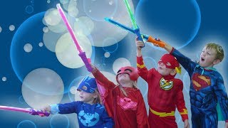 PJ Masks Bubble Fun with Superman and The Flash! PJ Masks find buried surprise toys