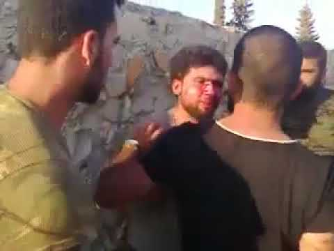 Download A Syrian tortured by the Assad Militia.