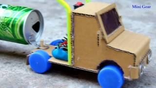 Làm xe đồ chơi đơn giản từ nắp chai, vỏ lon và bìa các tông