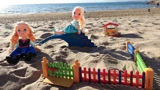 Gambar cover Elsa and Anna toddlers at the beach playground