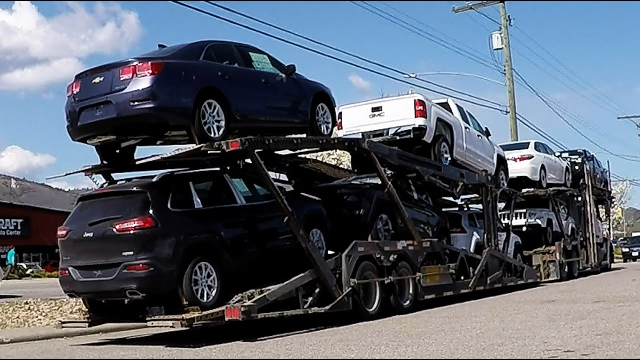 AUTO TRANSPORT CARRIER:  Sped-up Unload. [Unload Takes 6 Min.] -- Jeep, GM, Toyota (Car Hauler)