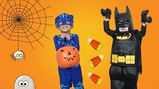PJ Masks Cat Boy Goes Trick or Treating and Gets Lots of Candy and Toy Surprises
