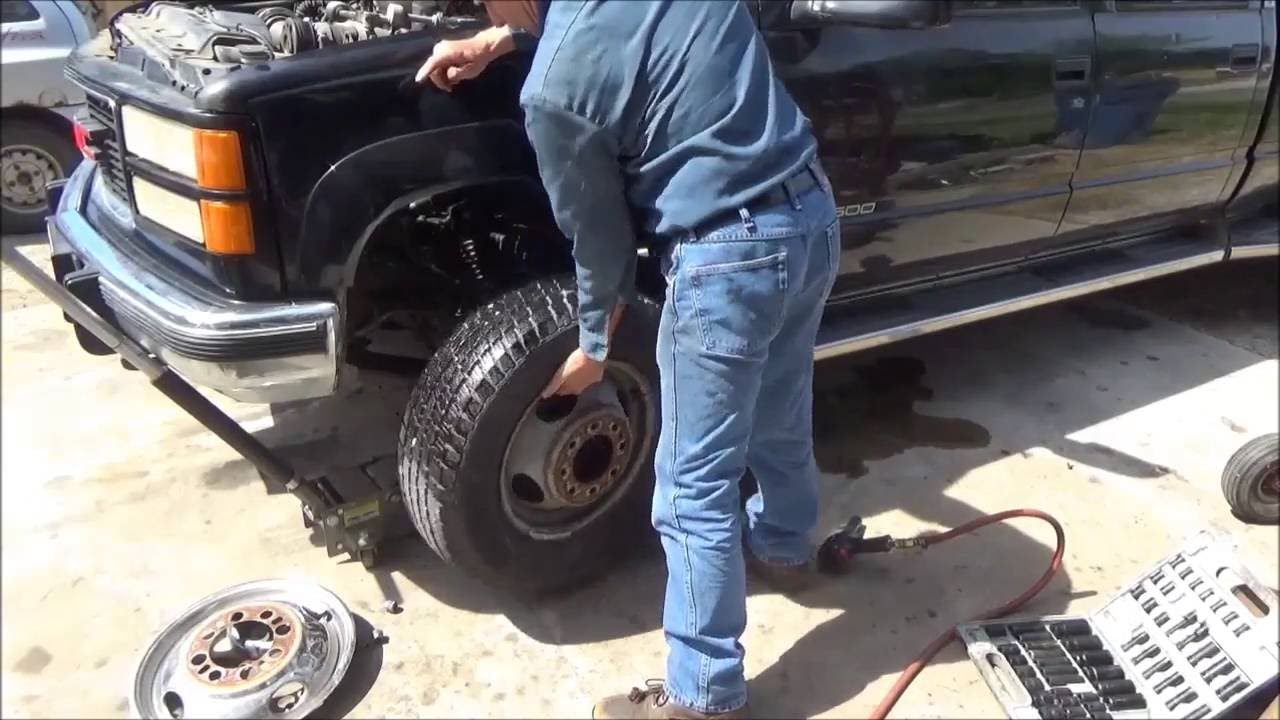 How to change front brake calipers and rotors on a gmc or chevy 4x4 dually