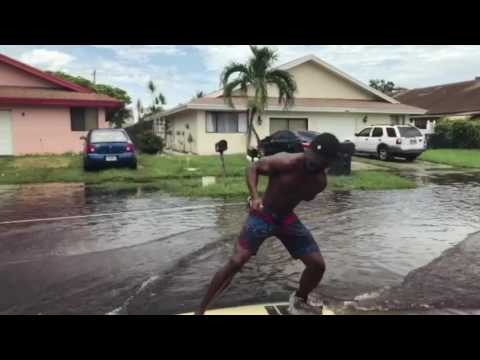 People 'Surf' Through Flooded South Florida Streets