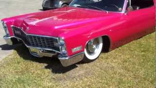 Pink 67 Cadillac Couple Deville Slammed on the ground