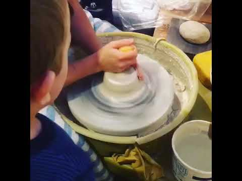 Centering clay on the potter's wheel (with little kids!)