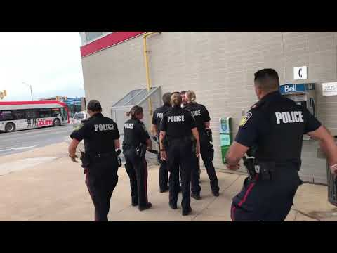Canadian Region Of Peel Police Officers Arresting An Unruly Man At Brampton Gateway Bus Terminal