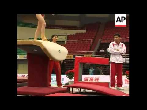 China's gymnastic team faces questions over age of three young stars