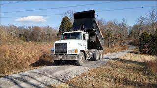 Dump truck tailgating gravel on Mile long driveway & beautiful views