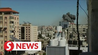 The moment office tower in Gaza hit by Israeli missile strike