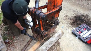 Abandoned digger gets new bucket/hitch pins and widens a narrow trail.