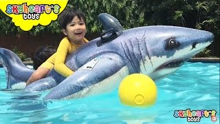 Skyheart rides the GIANT SHARK - swimming toys for kids playtime with inflatables and surprise eggs