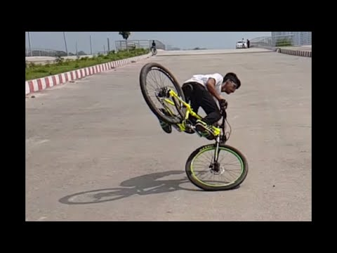 How To Do A Rolling Stoppie | MTB STUNT TRICKS | Tamal Rahman