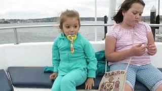 adorable kids dancing  while eating smoothie on Jetty Island ferry off the coast of Everett Washingt