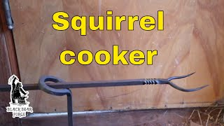 Squirrel cooker for cooking over the camp fire (you don