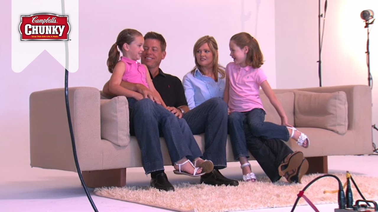 Caption: Troy and Rhonda with their daughters: Jordan and Alexa. They are posing for the family photo shoot.