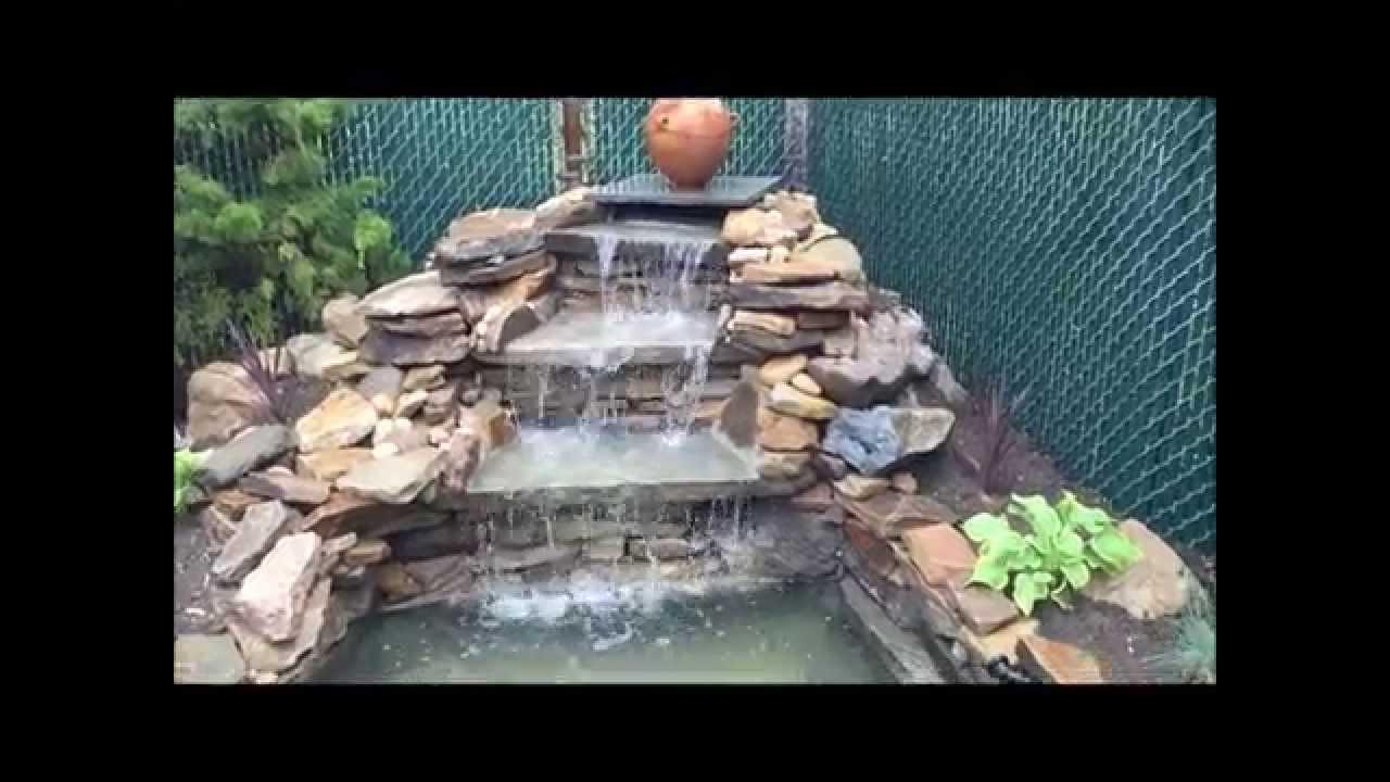 Waterfall and koi pond builder long island n y youtube for Koi pond waterfall