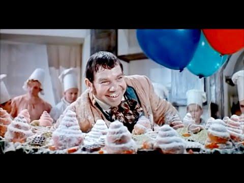 Фрагмент из фильма «Три толстяка» с вывозом огромного торта с человеком.