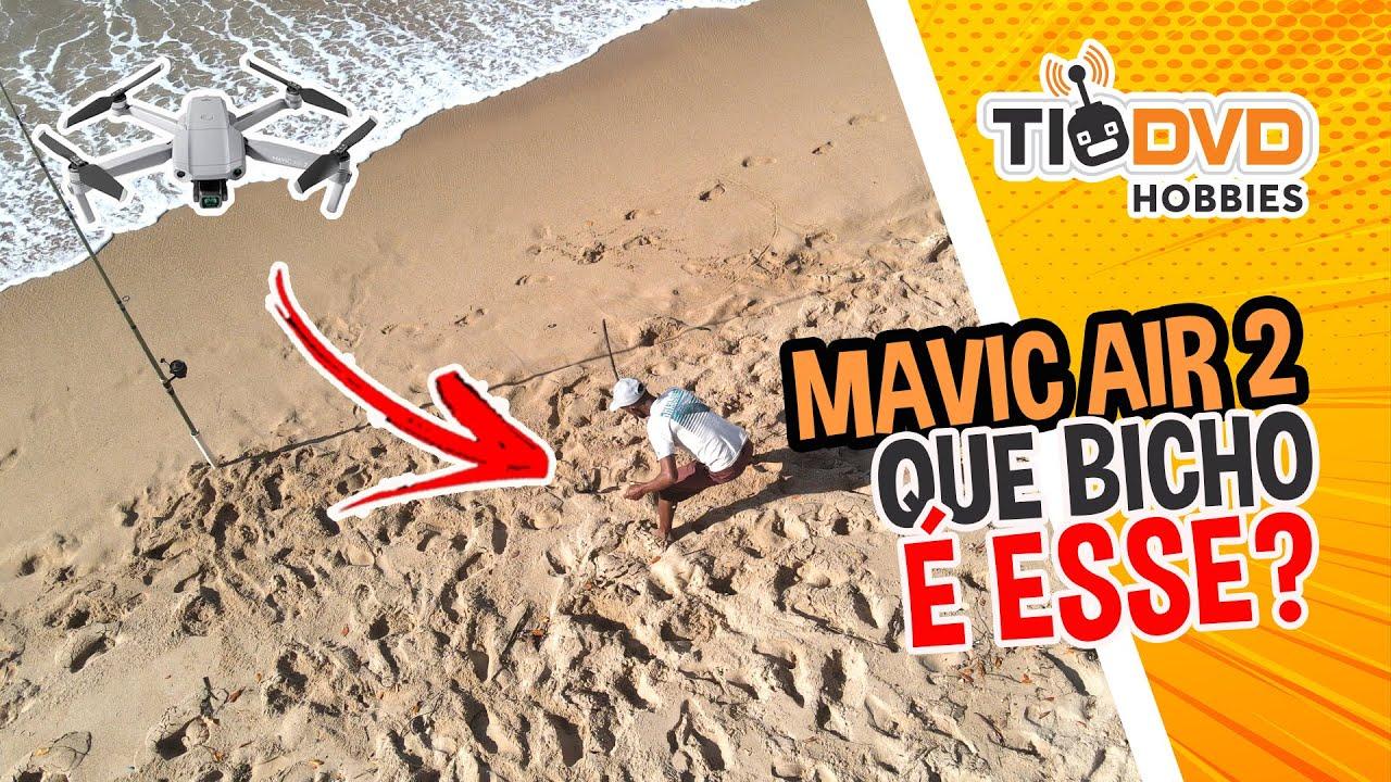 DJI MAVIC AIR 2 FLAGRA HOMEM RETIRANDO BICHO ESTRANHO DO MAR E GALERA DO SURF - DRONE COM GPS CAMERA