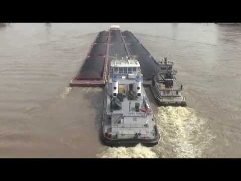 Coal barge upstream in flood at Cincinnati