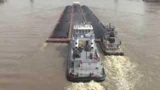 Coal barge upstream in flood at Cincinnati