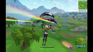 Search between a covered bridge, waterfall, and the 9th green Fortnite Challenge Guide