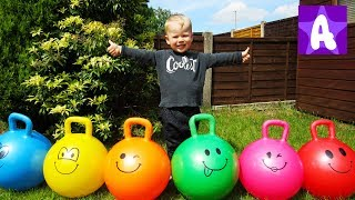 Funny Alex playing and having fun with colorful Skippy bouncing Balls
