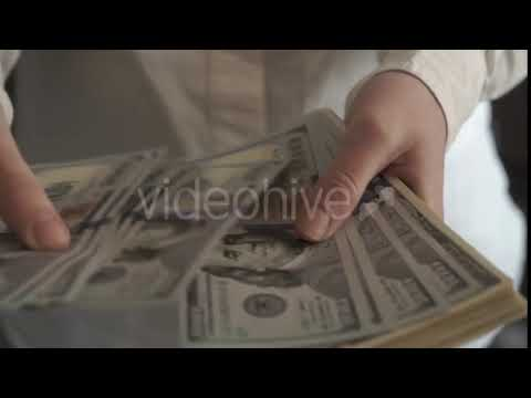 Blurred People Image Background. Business Finance Market. Woman Holding American Dollars in Hands |