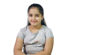 Young cute Indian girl happily smiling isolated over white background