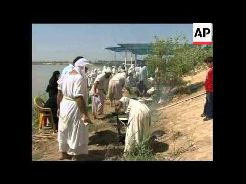 Followers Of Ancient Religion Undergo Baptism