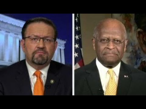 Sebastian Gorka and Herman Cain on the
