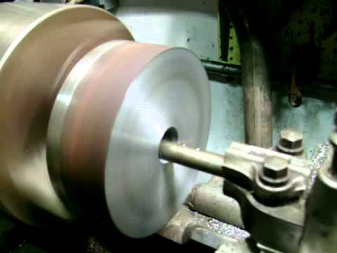 Boring hole in a 6 inch solid steel bar with a 13 inch South Bend Lathe.